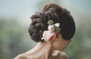 Twisted Textured Updo With Fresh Flowers via OneWed
