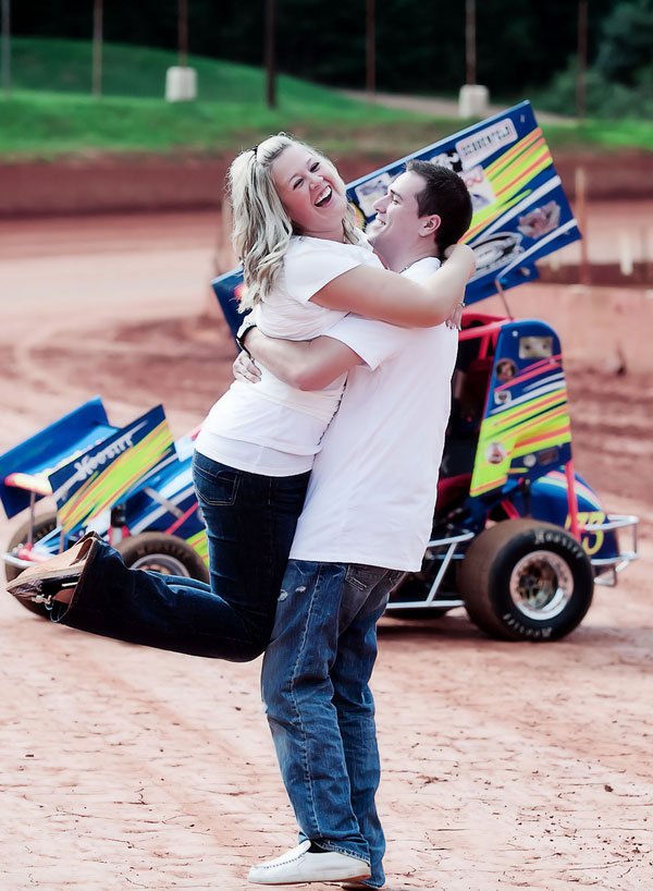 Love On The Speedway, Race Track Engagement Photos With Checkered Flags & Beer Showers | Photograph by Mila Bridger Photography