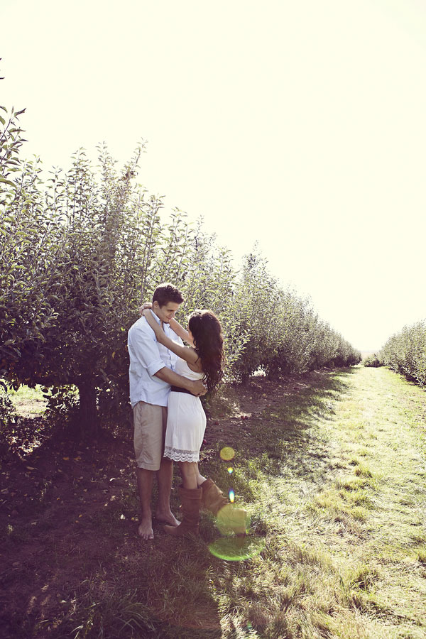 Fall Time Sun Kissed Apple Orchard High School Sweethearts Engagement Session   Photograph by Dana Ann Photography