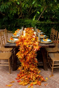 Autumn Foliage Wedding Fit For A Princess Featuring A Floor Length Leaf Table Runner | Photograph by Foskett Creative