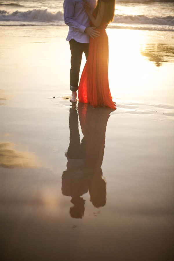 Dancing On The Shore In This Manhattan Beach Sunset Engagement Session | Photograph by T. C. Engle Photography