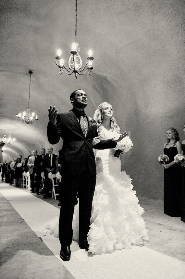 Unique Worship Inspired Cave Wedding With Purple Tones At The Wente Vineyards   Photograph by Gina Petersen Photography
