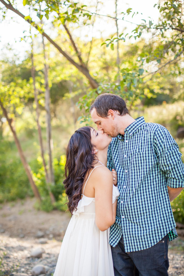 Alaska Summertime Fishing Engagement Session Nestled Along A Babbling Brook   Photograph by Katelyn Owens Photography