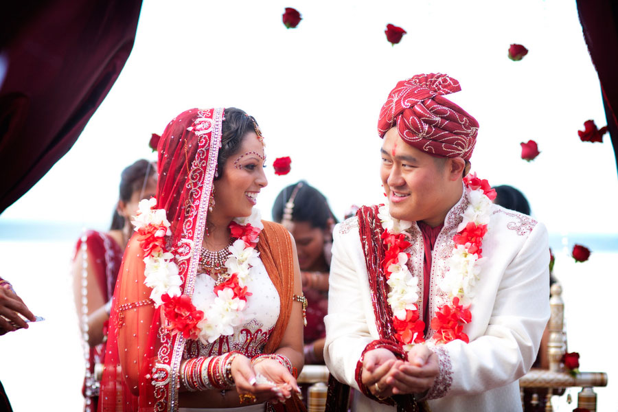 Dual Faith Buddhist Hindu Wedding In Bold Red & Bright Metallics | Photograph by Limelight Photography