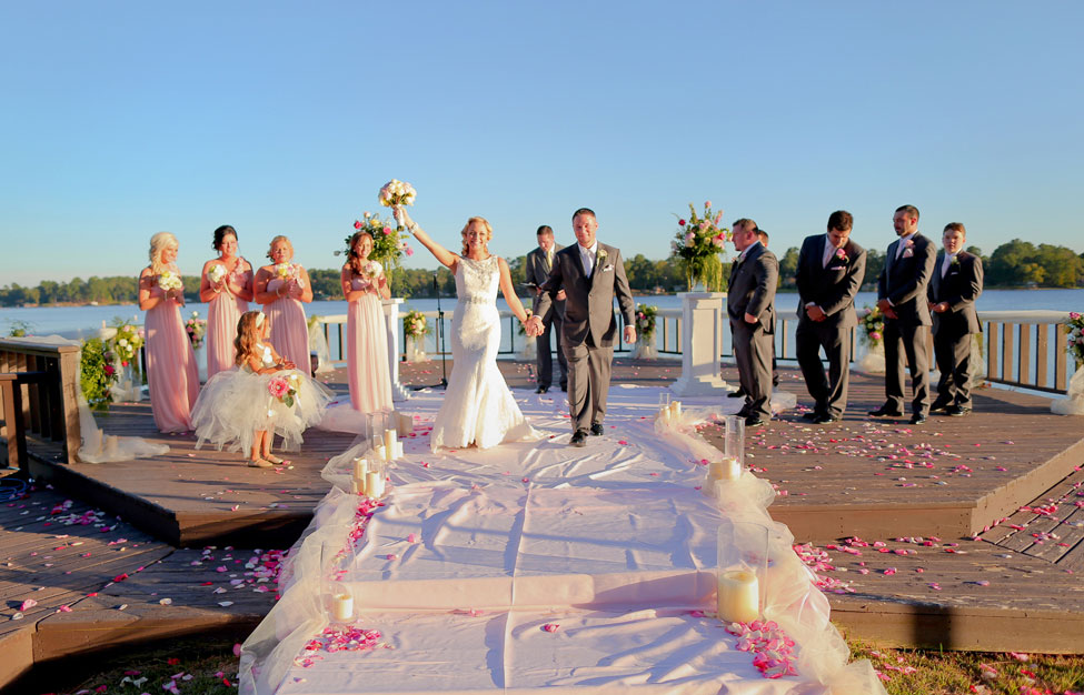 Romantic Lake Side Sunset Wedding In Pink & Gold With Vintage Touches Of Lace, Bottles, Watches & More | Photograph by Photography by Gema  https://www.storyboardwedding.com/romantic-lake-side-sunset-wedding-pink-gold-vintage-touches/