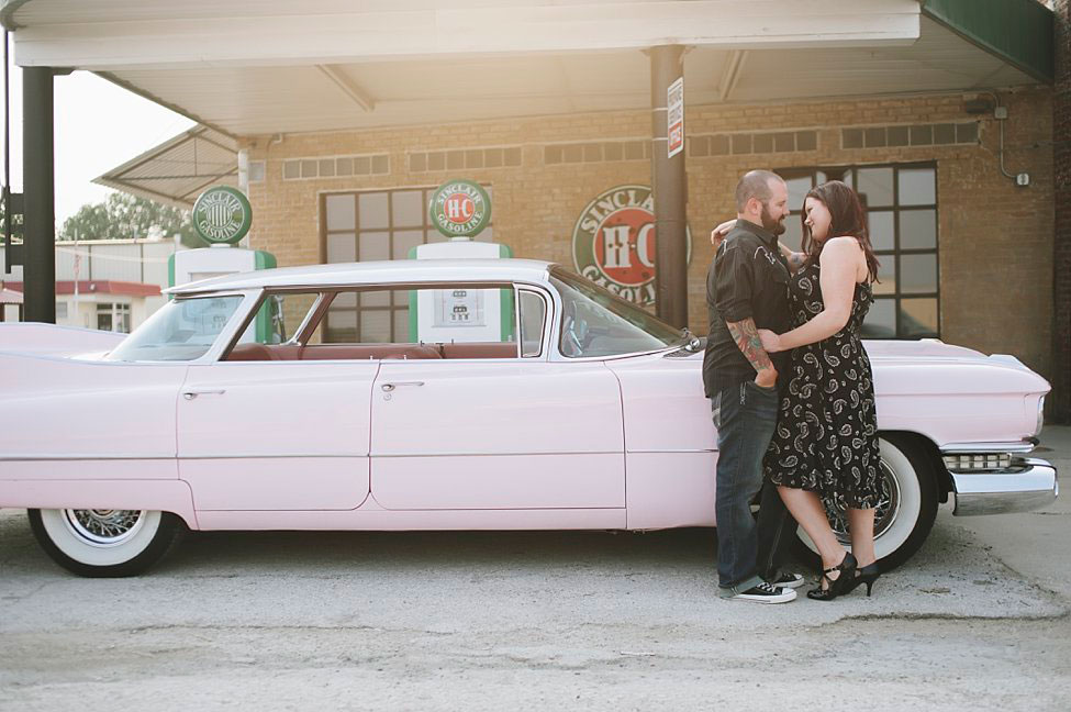 Pink Cadillac Engagement Session With Edgy Retro Flair From Old Gas Stations To Classic Car Graveyards | Photograph by Tracy Enoch Photography  https://storyboardwedding.com/vintage-retro-pink-cadillac-engagement-session/