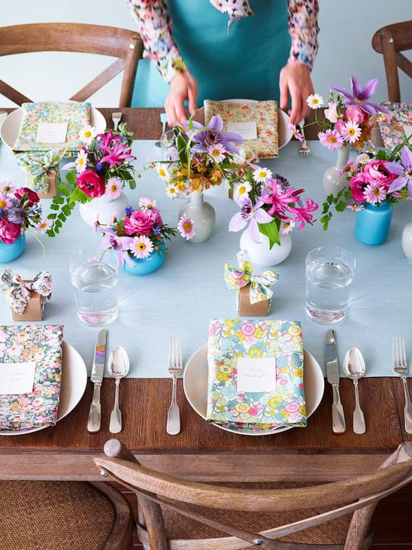 Wood Table Setting With Floral Accents via Thuss + Farrell