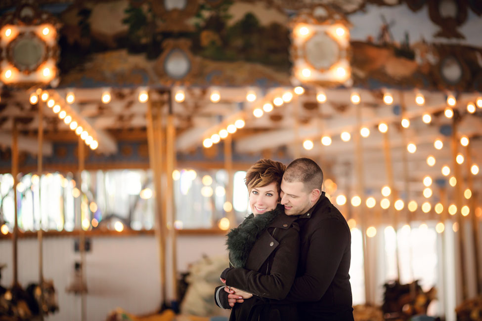 New Haven Connecticut Lighthouse Point Park Carousel Engagement Session | Photograph by Christina Corneau Photography   https://storyboardwedding.com/new-haven-connecticut-lighthouse-point-park-carousel-engagement-session/