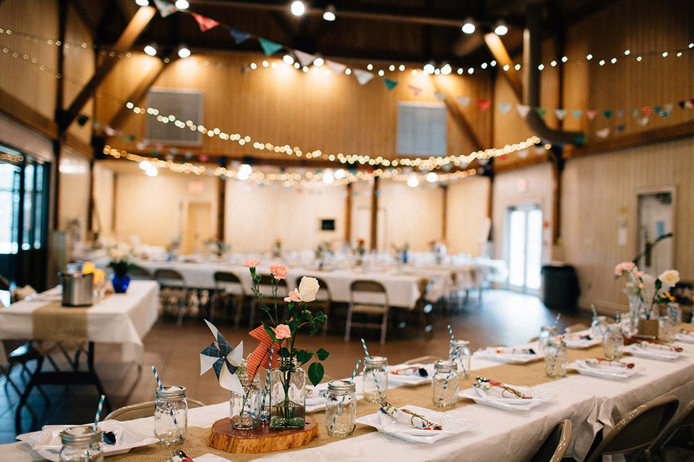 Pinwheel Filled Whimsical Red Barn Wedding With Vintage Touches | Photograph by Blest Photography  https://storyboardwedding.com/pinwheel-whimsical-red-barn-wedding-vintage/