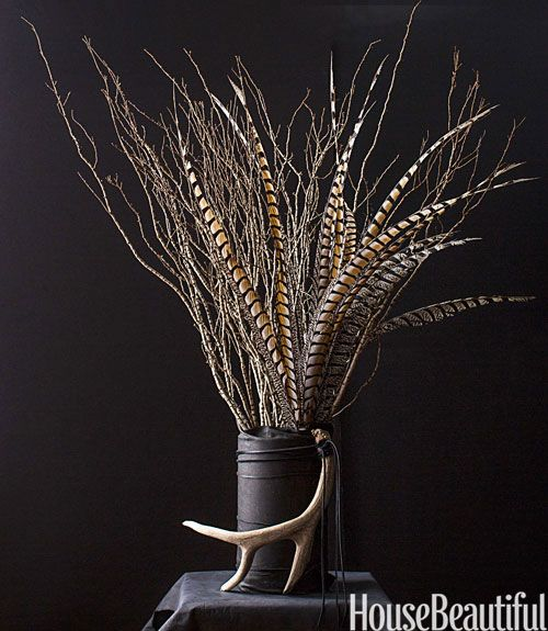 Pheasant feather and twig centerpiece