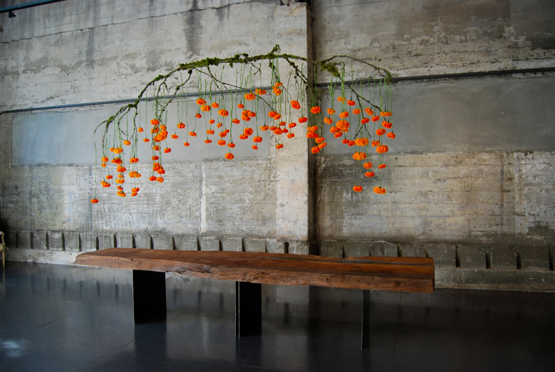 Suspended branch centerpieces marigold and mint