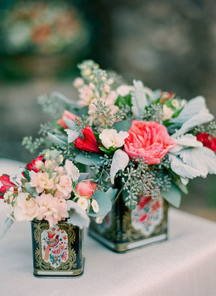 Pink flowers in tins Jana Morgan Photography
