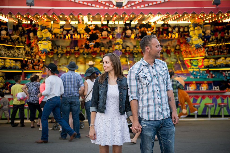 Sunset Amusement Park Engagement At Alberta's Calgary Stampede Rodeo | Photograph by Paisley Photography  http://storyboardwedding.com/amusement-park-engagement-alberta-calgary-stampede-rodeo/