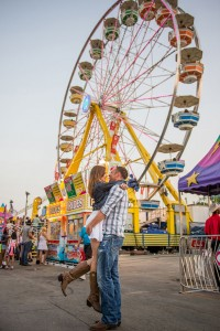 Sunset Amusement Park Engagement At Alberta's Calgary Stampede Rodeo