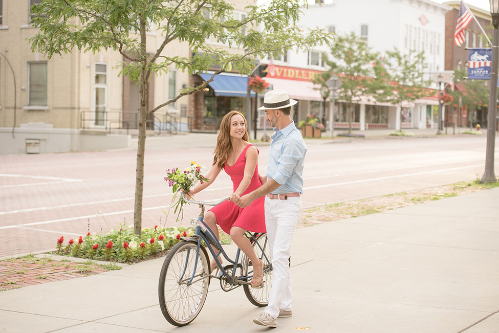 East Aurora Downtown Vintage Bike Engagement Session | Photograph by Alyissa Landri Photography  See The Full Story At http://storyboardwedding.com/east-aurora-downtown-vintage-bike-engagement-session/