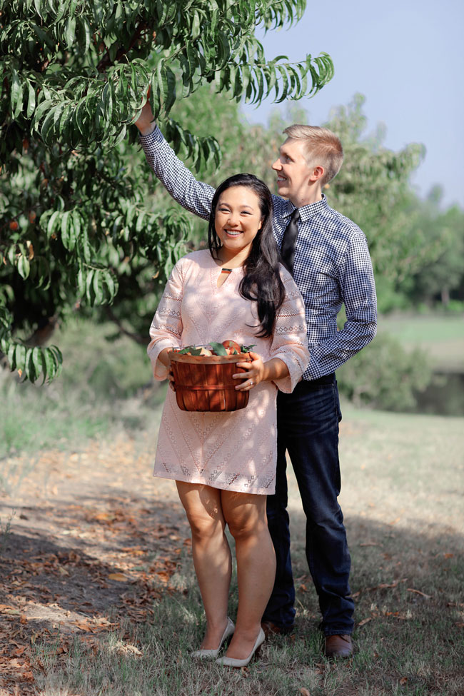 Sweet Summer Peach Orchard Engagement At The Venue At Orchard Farms In Texas  | Photograph by Photography By Gema See The Full Story At https://storyboardwedding.com/summer-peach-orchard-engagement-venue-at-orchard-farms-texas/