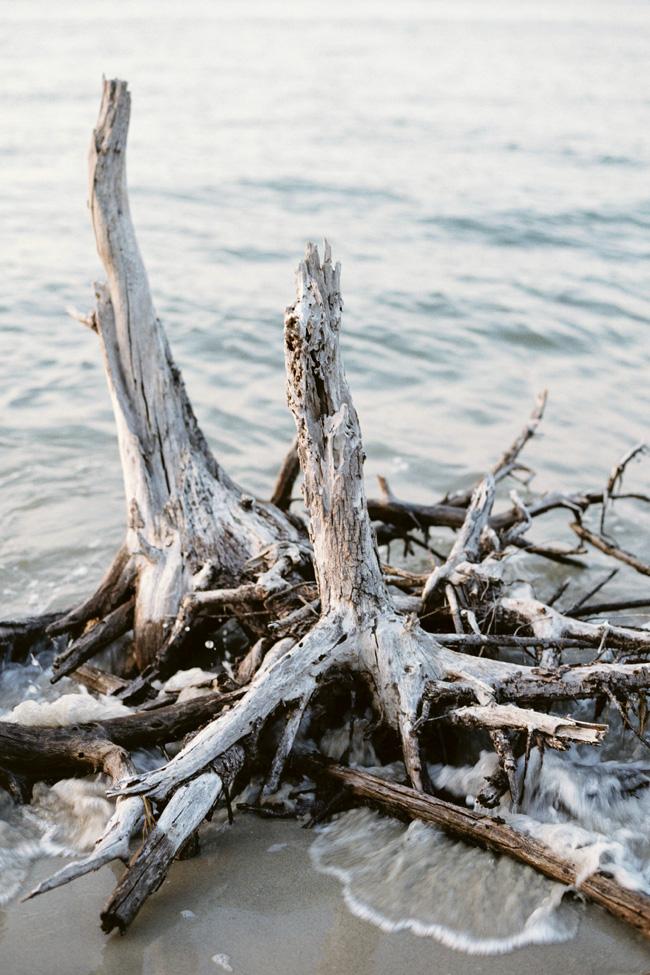 Sunset Bridal Beach Boudoir Session Along The Charleston Coastline | Photograph by JoPhoto  See The Full Story At https://storyboardwedding.com/sunset-bridal-beach-boudoir-charleston/