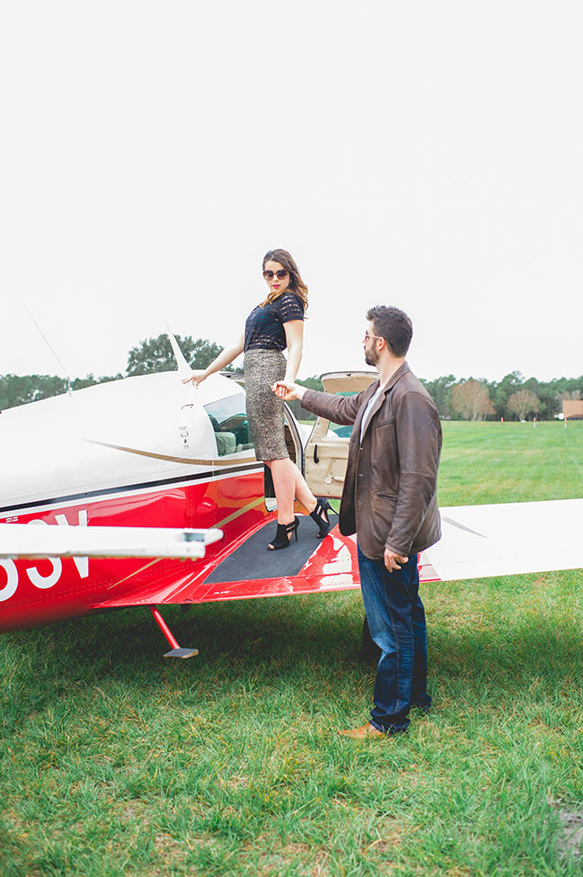 Chic Outdoor Travel Airplane Engagement On A Private Florida Residence | Photograph by Captured By Belinda  See The Full Story At https://storyboardwedding.com/outdoor-travel-airplane-engagement-florida/