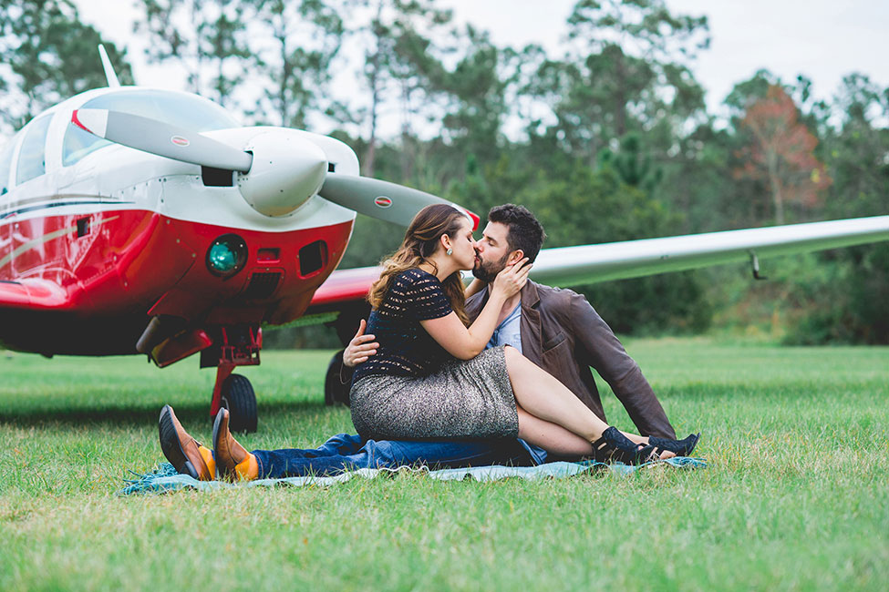 Chic Outdoor Travel Airplane Engagement On A Private Florida Residence | Photograph by Captured By Belinda  See The Full Story At http://storyboardwedding.com/outdoor-travel-airplane-engagement-florida/