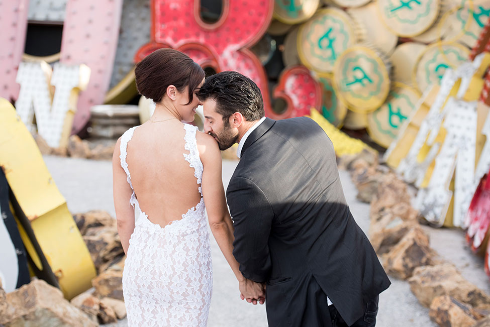 Iconic Las Vegas Neon Museum Engagement Session | Photograph by KMH Photography  See The Full Story at https://storyboardwedding.com/las-vegas-neon-museum-engagement-session/